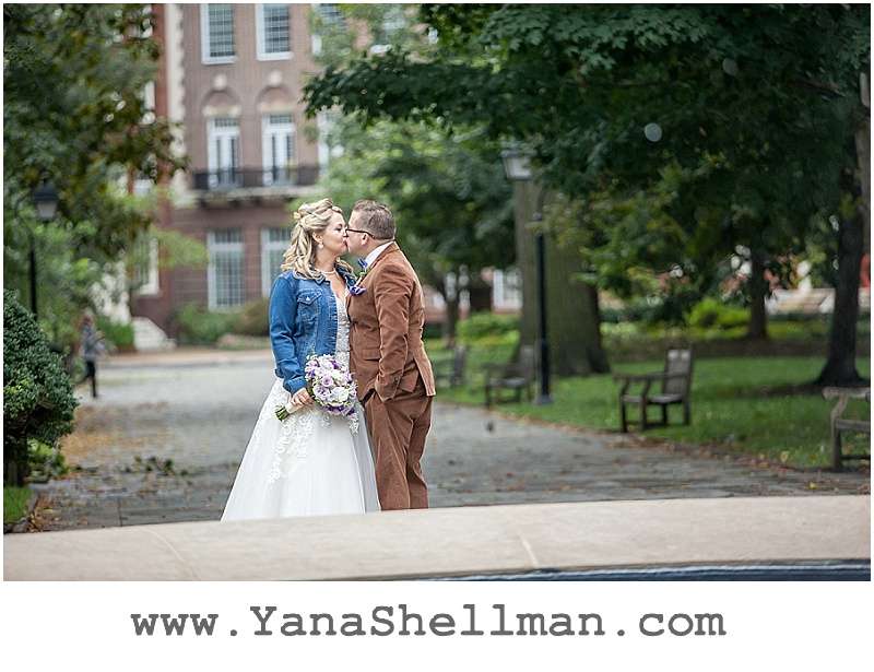 bride and groom kissing at Talula's Garden wedding by Philadelphia wedding photographer