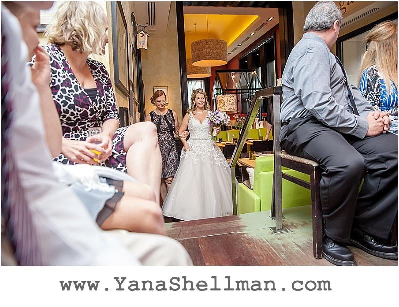 bride walking down the isle Talula's Garden wedding by Philadelphia wedding photographer