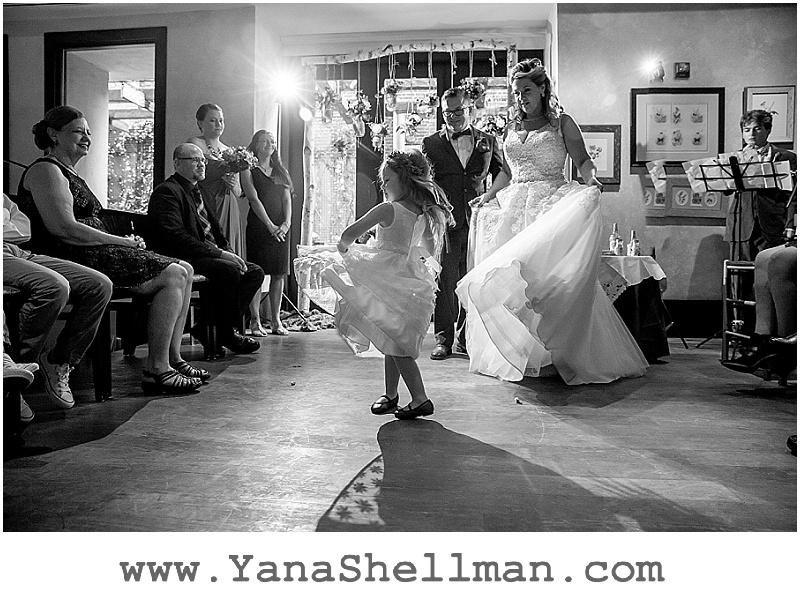 flower girl dancing at Talula's Garden wedding by Philadelphia wedding photographer