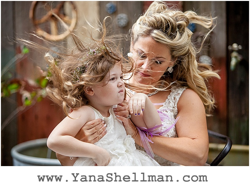 very windy photo at Talula's Garden wedding by Philadelphia wedding photographer